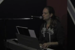 A piano student playing and singing Steppin' Stone