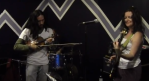 A violin teacher and bass student playing Stuck in the Middle